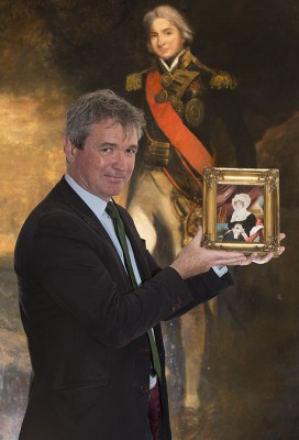 Martyn holding a newly-discovered portrait of Lady Nelson